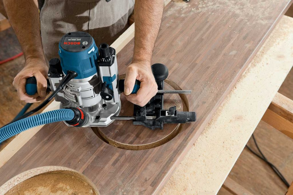 Bosch 120 Plunge router cutting wooden table circle